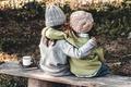 Two happy girls as friends hug each other. Little girlfriends in park. Children Friendship - PhotoDune Item for Sale