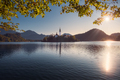 Scenic view of Lake Bled and island with church, colorful autumn foliage, Slovenia - PhotoDune Item for Sale