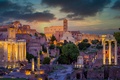 Forum Romanum and Colosseum in Rome with dramatic colorful sky - PhotoDune Item for Sale