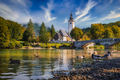 Scenic view of Lake Bohinj church with beautiful colorful foliage, Slovenia - PhotoDune Item for Sale