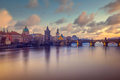 Cityscape view of Charles bridge in long exposure with beautiful sky, Prague - PhotoDune Item for Sale