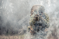 army soldier attacking enemies trough smoke screen - PhotoDune Item for Sale