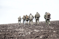 Army soldiers group on march in muddy field - PhotoDune Item for Sale