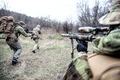 Commando army soldiers fighters squad rushing in woodland - PhotoDune Item for Sale