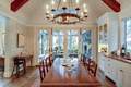 Beautiful diningroom with view onto porch and waterfront property. - PhotoDune Item for Sale