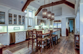 Large expensive chefs kitchen in luxury home with rough hewn wood and white cabinets. - PhotoDune Item for Sale