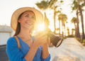 Photographer tourist woman taking photos with camera in a beautiful tropical landscape at sunset - PhotoDune Item for Sale