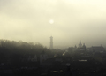 Historic center of Lviv in dense fog. Silhouette of the sun over the town hall. Ukraine - PhotoDune Item for Sale