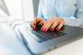 Female hands with bright manicure typing on a laptop keyboard - PhotoDune Item for Sale