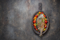 Fried whole fish with vegetables on cutting board, copy space - PhotoDune Item for Sale