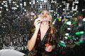 Young glamorous woman in glittering dress blowing soap bubbles at party - PhotoDune Item for Sale