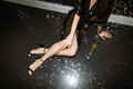 Young glamorous woman in glittering sequin dress relaxing on the floor - PhotoDune Item for Sale