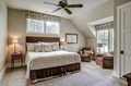Beautiful luxurious upstairs bedroom with ample windows and leather furniture. - PhotoDune Item for Sale