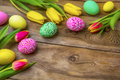 Easter wooden background  with eggs and yellow red tulips - PhotoDune Item for Sale