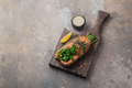Fried salmon steak with asparagus on wooden board, copy space - PhotoDune Item for Sale