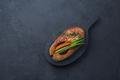 Fried salmon steak on black wooden board, dark photo copy space - PhotoDune Item for Sale