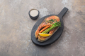 Grilled salmon steak with vegetables on wooden board, copy space - PhotoDune Item for Sale