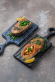 Two salmon steaks with vegetables on wooden boards, copy space - PhotoDune Item for Sale