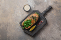 Fried salmon steak with vegetables on wooden board, copy space - PhotoDune Item for Sale