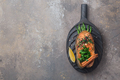 Fried salmon steak with vegetables on wooden board, flat lay copy space - PhotoDune Item for Sale