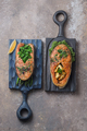 Two salmon steaks with vegetables on wooden boards, top view copy space - PhotoDune Item for Sale