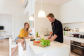 Couple making lunch on a white kitchen at home - PhotoDune Item for Sale