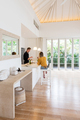 Couple cooking on a white island kitchen at home - PhotoDune Item for Sale