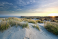 sunrise over sand dunes by north sea coast - PhotoDune Item for Sale