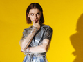 young fashionable female model in trech isolated on yellow background - PhotoDune Item for Sale