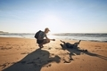 Young man with dog on beach - PhotoDune Item for Sale