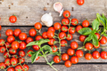 Fresh cherry tomatoes on a wooden table. - PhotoDune Item for Sale
