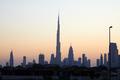 Dubai skyline with Burj Khalifa skyscraper at sunset, clear sky in United Arab Emirates - PhotoDune Item for Sale