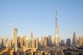 Dubai city skyline with Burj Khalifa skyscraper in a sunny day, blue sky - PhotoDune Item for Sale