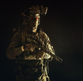 Portrait of elite commando fighter in darkness - PhotoDune Item for Sale