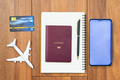 Airplane by passport and cellphone with notepad-2 - PhotoDune Item for Sale