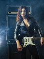 Beautiful woman with red hair holding electric guitar - PhotoDune Item for Sale