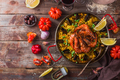 Top view of paella with prawns, mussels and lemon, wooden background - PhotoDune Item for Sale