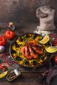 Traditional paella with shrimps, calamari and mussels in paellara pan - PhotoDune Item for Sale