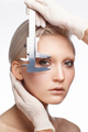 beauty close up portrait of blonde woman with measure devices near face - PhotoDune Item for Sale