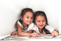 two girls reading under blanket - PhotoDune Item for Sale