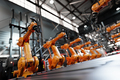 Robotic arms along assembly line in modern factory. - PhotoDune Item for Sale