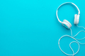 Minimal Photo Of White Headphones With Cable On Blue Background With Copy Space. - PhotoDune Item for Sale