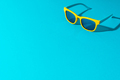 Minimalist Photo Of Sunglasses On Turquoise Blue Background With Copy Space - PhotoDune Item for Sale