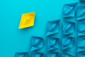 Yellow Paper Ship Out Of The Crowd Concept Over Blue Background - PhotoDune Item for Sale