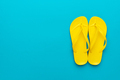 Yellow Beach Flip-Flops On The Blue Background - PhotoDune Item for Sale