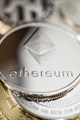 Close-Up Of Ether Physical Coin On Stack Of Many Other Cryptocurrencies - PhotoDune Item for Sale