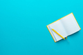 Top View Of Opened Notebook And Pen On Turquoise Blue Background With Copy Space - PhotoDune Item for Sale