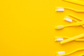 Plastic Toothbrushes On Yellow Background - PhotoDune Item for Sale