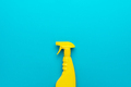 Yellow Plastic Dispenser On Blue Background With Copy Space - PhotoDune Item for Sale
