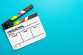 Top View Of Open White Clapperboard On Turquoise Blue Background And Copy Space - PhotoDune Item for Sale